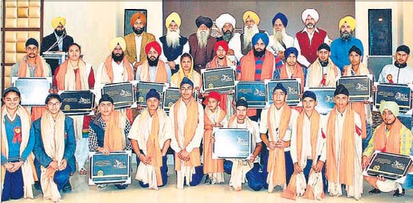 Marathon runner Fauja Singh (third from left, back row) and members of an NGO honouring Sikh athletes in Amritsar