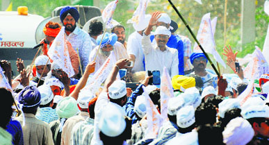 AAP chief Arvind Kejriwal during a roadshow in support of HS Phoolka in Ludhiana