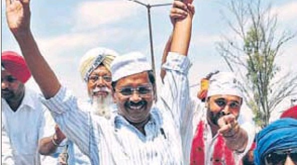 Aam Aadmi Party convener Arvind Kejriwal waving during a roadshow in Malerkotla on Sunday in favour of party candidate from Sangrur Bhagwant Mann