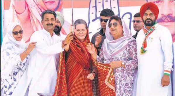 Congress president Sonia Gandhi flanked by the party's Sangrur candidate Vijay Inder Singla and campaign panel head Rajinder Kaur Bhattal during a rally in Barnala on Saturday