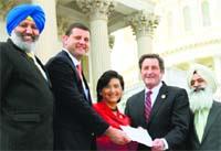 Harpreet Sandhu, Congressman Valadao, Congresswoman Chu, Congressman Garamendi and Pritpal Singh hold a copy of the resolution outside the US Capitol.