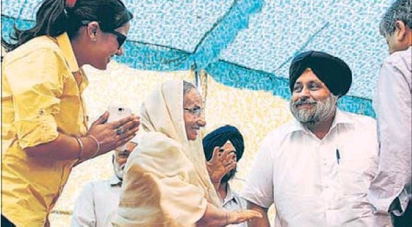 Joginder Kaur, daughter of former President of India late Giani Zail Singh with deputy chief minister and SAD president Sukhbir Singh Badal, at a party function in Bathinda on Monday. Punjabi actress Pinky Sandhu, p