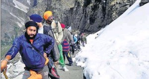 Sikh pilgrims trek through a snow-flanked path en route to Hemkunt Sahib in Uttarakhand; and (below) toilets rendered useless in the absence of water.