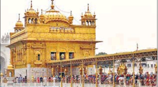 Devotees at the Golden Temple on the martyrdom day of Guru Arjan Dev in Amritsar on Sunday.