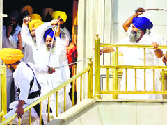 Members of the SGPC task force and SAD (Amritsar) activists clash at Akal Takht in Amritsar on Friday.