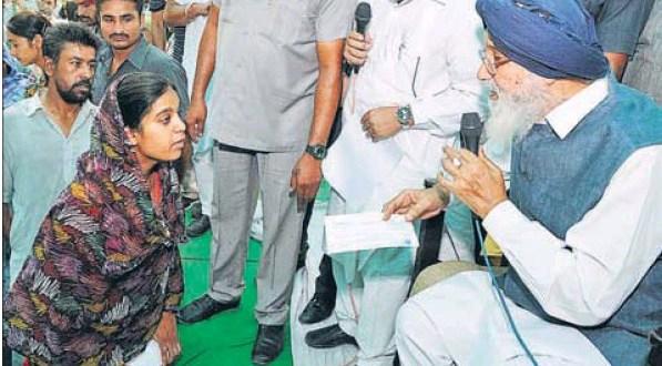 Punjab chief minister Parkash Singh Badal hearing the grievance of a woman at a sangat darshan in Talwandi Sabo