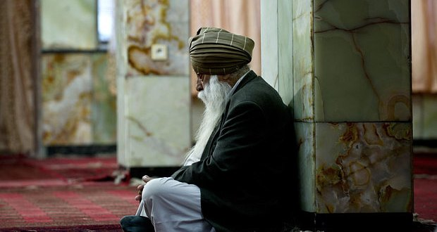 An Afghan Sikh prays at a Sikh Gurdwara in Kabul