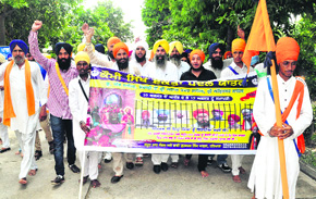 Gurbaksh Singh Khalsa (fourth from left) leads the Kaumi Sikh Ekta Paidal Yatra, which started from Gurdwara Sri Amb Sahib at Phase VIII in Mohali on S