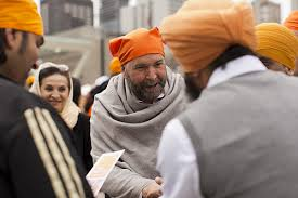 TOM MULCAIR,