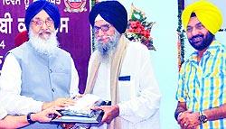 Chief Minister Parkash Singh Badal honours Jasdev Singh Jassowal in Patiala