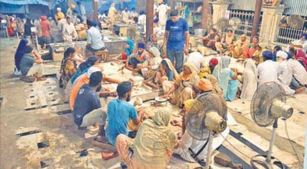 Devotees cook for the J&K flood victims at the Golden Temple in Amritsar