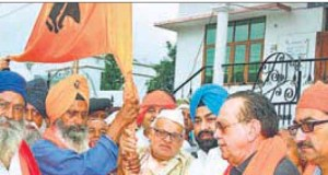 Uttarakhand governor Dr Aziz Qureshi (centre) flagging off the pilgrims' group in Dehradun on Monday.
