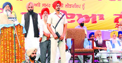 Chief Minister Parkash Singh Badal addresses a gathering at the death anniversary of Darshan Singh Pheruman at Pheruman village near Amritsar