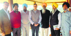 SGPC officials with J&K CM Omar Abdullah in Srinagar.