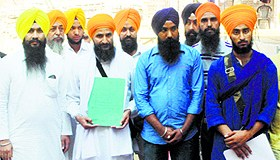 Sikh activist Gurbaksh Singh Khalsa (holding papers) with his supporters in Amritsar