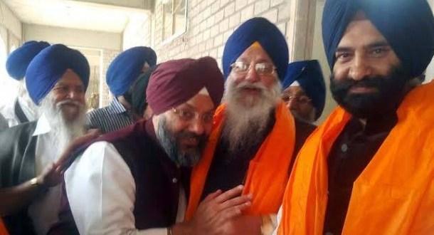 GK Singh congratulating SGPC Chief. Photo: GK Singh's Facebook post.