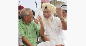 AAP MP from Patiala Dharamvira Gandhi (left) and Harinder Singh Khalsa, Fathegarh Sahib MP during a rally at Baba Bakala.