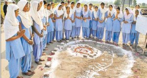 School girls paying obeisance at the site where one of the two firing victims fell to Punjab Police bullets at Behabal Kalan village in Faridkot on Saturday.