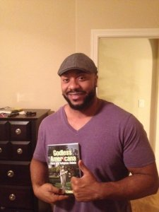 Writer James Stone and his copy of Godless Americana.