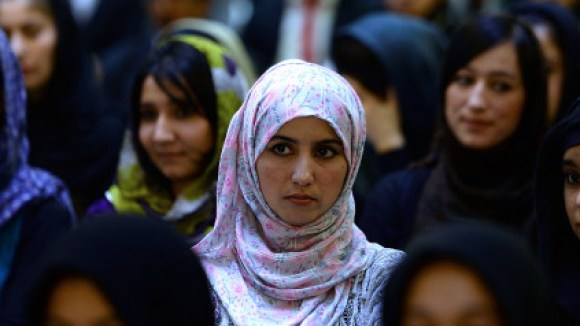 Photo Credit: Shah Maria/AFP/Getty Images  Afghan women listen to a speaker address a political gathering at a wedding hall in Kabul on Sept. 26. Many Afghanistan policy experts worry that the U.S. withdrawal will hit programs that help women and girls. (SHAH MARAI/AFP/Getty Images) | Getty