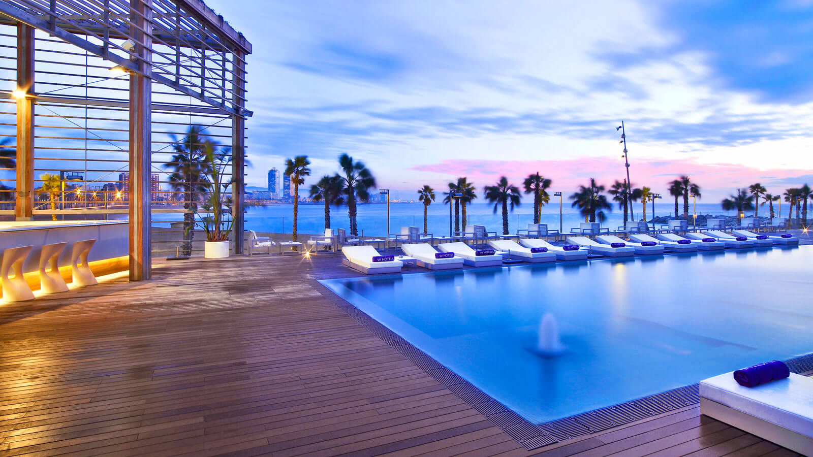 Astounding Outdoor Relaxing Space Design Applied Inside W Hotel Barcelona Near Several Clear Colored Beach Chaises Along With Wide Blue Pool Silver Creek Hotel