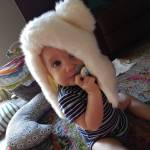 ISpendMySaturdayMornings with a polar bear hat and a pacifier