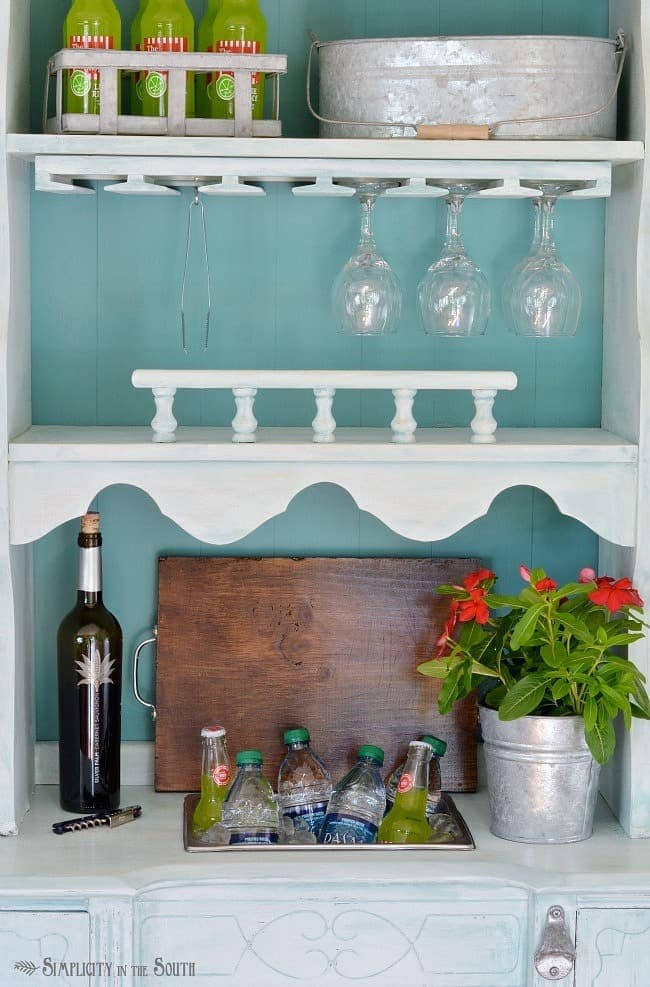 Repurposed desk and hutch made into a beverage station