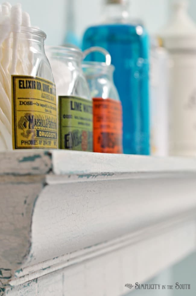 apothecary jars and crackle paint shelf