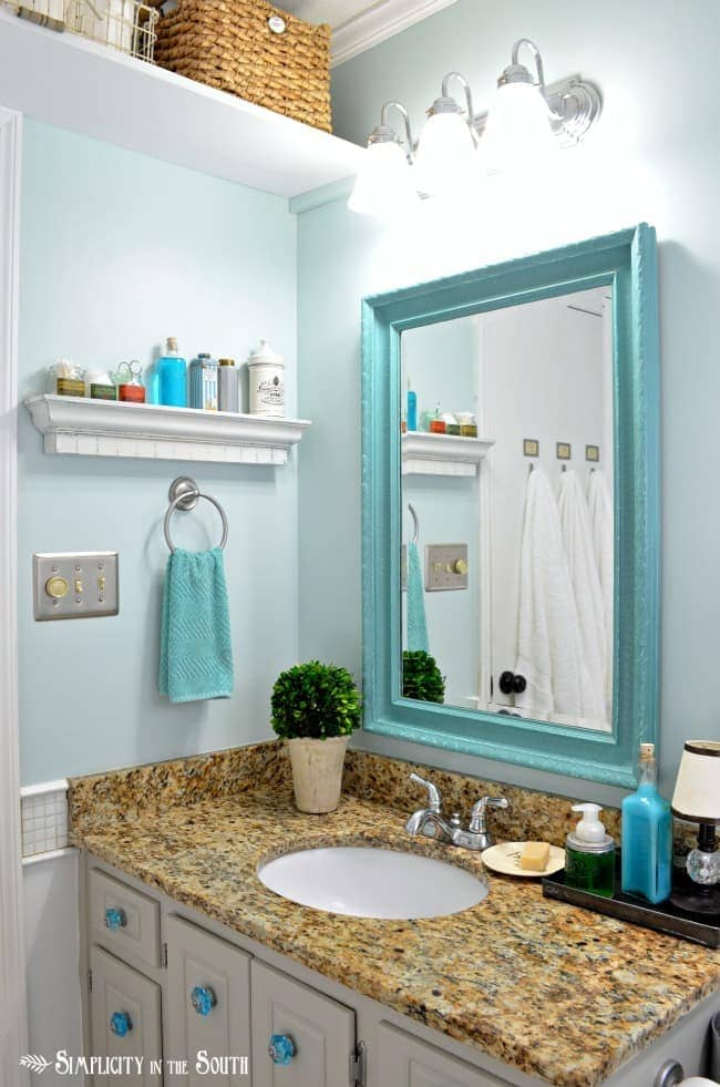 guest bathroom with turquoise mirror