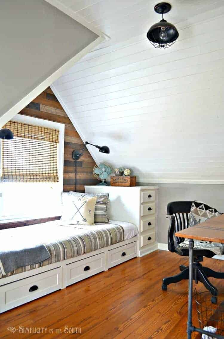 Cozy eclectic dormer bedroom with a built in bed and planked wall and ceilings