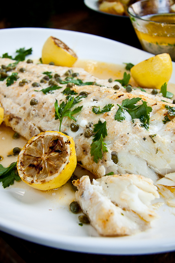 Baked fish with lemon butter capers simply delicious for Cooking with fish sauce