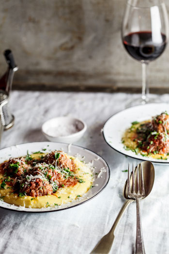 Meatballs baked in tomato sauce on polenta