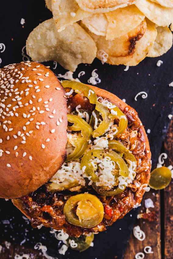 Big, gooey slow-cooked, shredded beef Sloppy Joes topped with sharp mature cheddar and tangy pickled jalapeños is your childhood favorite beefed up.