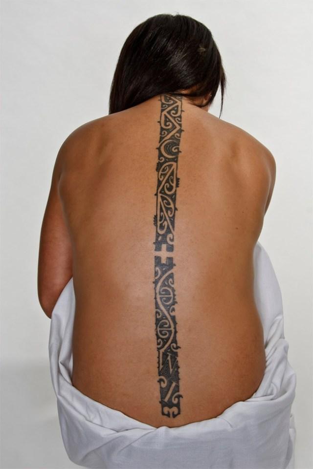 fine line on back maori tattoo