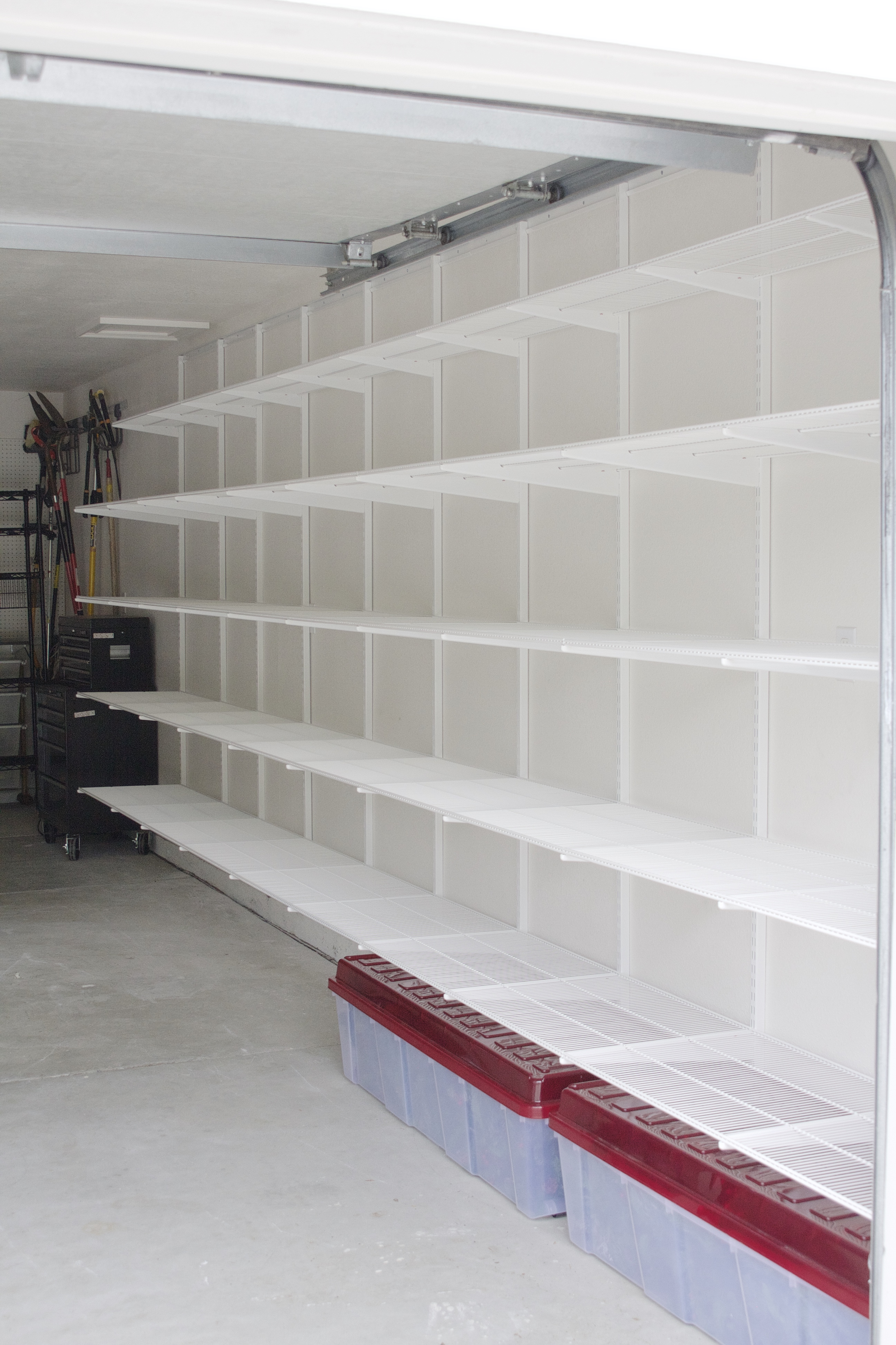 Adjustable Wall Shelf System Simply Done Custom Wall Of Garage Shelving Simply Organized