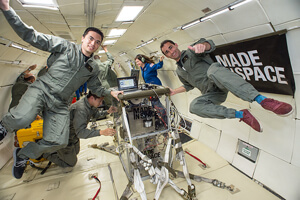 Made In Space cofounders testing their tech in simulated microgravity.