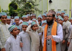 "Indian Muslim cleric Mohammed Manzar Hasan Ashrafi Misbahi, right speaks with Islamic students at the Ajmeri Masjid in Mumbai, India, Wednesday, Sept. 9, 2015. More than 1,000 Muslim clerics in India have ratified a religious ruling that condemns the Islamic State and calls the extremist group's actions ""un-Islamic, Misbahi said Wednesday.(AP Photo/Rafiq Maqbool)"