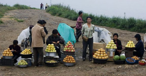 Where the subversion starts; a roadside market in North Korea   via Japan Focus