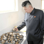 Kim Jong Un Looking at Clams