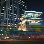 """Seoul's Namdaemun (South Gate). The epitome of a """"big lights, big city"""" infrastructure and atmosphere. Image: TylerDurden1/Wikipedia, Creative Commons 2.0"""