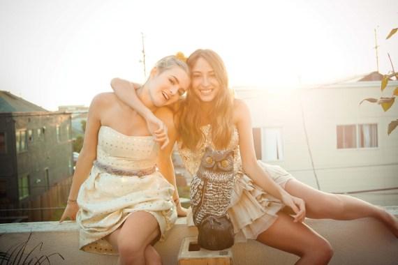 Two girl dressed up having fun