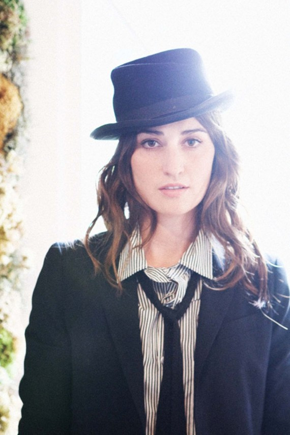 Woman in a suit and a top hat