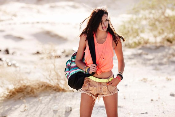 Girl in cut off jean shorts and a tank in the desert