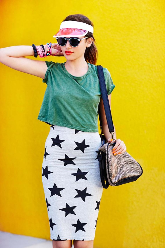 Girl with black and white stared skirt on and green top