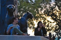 Jacob Jones '17 (left) and Audrey Wang '17 (right) eat dinner and share a laugh by Earle Flagpole.