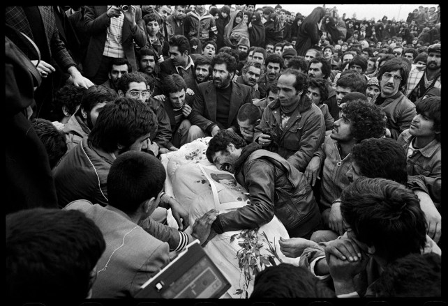 """Iranian Revolution, Tehran, Iran, 1978 Burnett arrived in Tehran the day after Christmas 1978, unaware of the degree of political unrest around him. Within hours, he was on the streets, in the middle of a gunbattle. """"Every burial became a political event,"""" he notes, """"where the shah and the U.S. were railed against."""""""