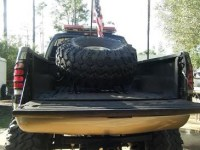 Big truck bed mounted spare tire rack