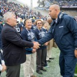 Penn State football Coach James Franklin greets Penn State President Eric Barron before the coin toss. Military Appreciation Day, Penn State vs. Army, Oct. 3, 2015.