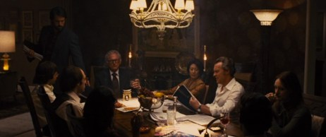 "The six American diplomats look over their ""scripts"" - part of the materials that establish their cover as filmmakers.  Still from DVD of Argo, directed by Ben Affleck, produced by Warner Brothers."