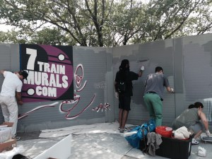 Volunteers putting down primer for the new mural on Monday. Courtesy Long Island City Partnership.